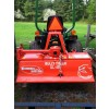 rotary tiller on sub-compact tractor